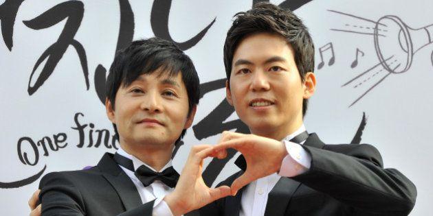 Kim Jho Gwang-Soo (L), a South Korean movie director who is gay, and his partner Kim Seung-Hwan (R),...