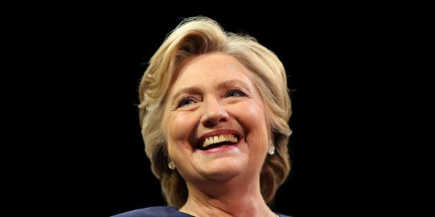 U.S. Democratic presidential nominee Hillary Clinton smiles as she greets the crowd at a fundraiser in...