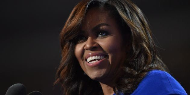 US First Lady Michelle Obama addresses delegates on Day 1 of the Democratic National Convention at the...