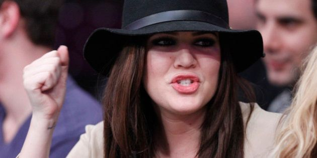 Actress Khloe Kardashian watches the Los Angeles Lakers play the Sacramento Kings during their NBA basketball game in Los Angeles, California, January 28, 2011.   REUTERS/Lucy Nicholson (UNITED STATES - Tags: SPORT BASKETBALL ENTERTAINMENT PROFILE)