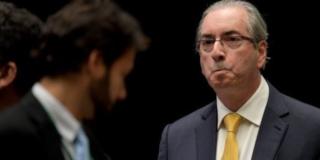 The former president of Brazil's lower house Eduardo Cunha (R) during a session in the Chamber of Deputies...