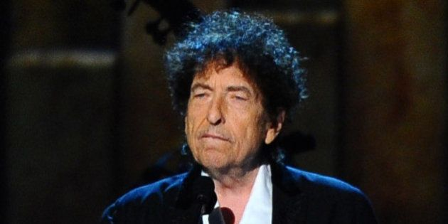 FILE - In this Feb. 6, 2015 file photo, Bob Dylan accepts the 2015 MusiCares Person of the Year award...