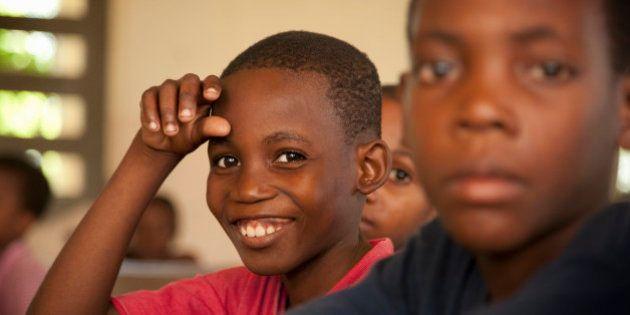 Young 10-14 boys in Haiti in school at desks