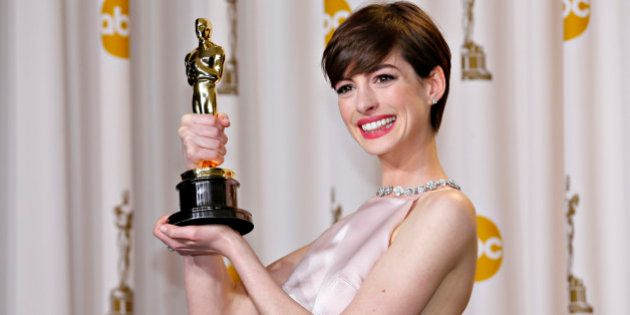 Anne Hathaway holds her Oscar for winning Best Supporting Actress for her role