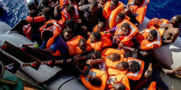 Rescued people board the Bourbon Argos ship during a rescue operation coordinated by MSF (Medecins Sans...