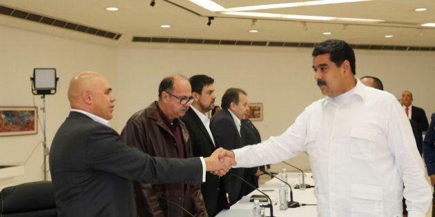 Venezuela's President Nicolas Maduro (R) shakes hands with Jesus Torrealba (L), secretary of Venezuela's...