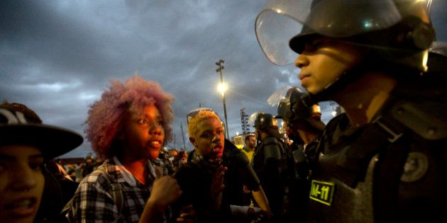 Students argue with the police during a protest against the money spent on the Rio 2016 Olympics in Rio...