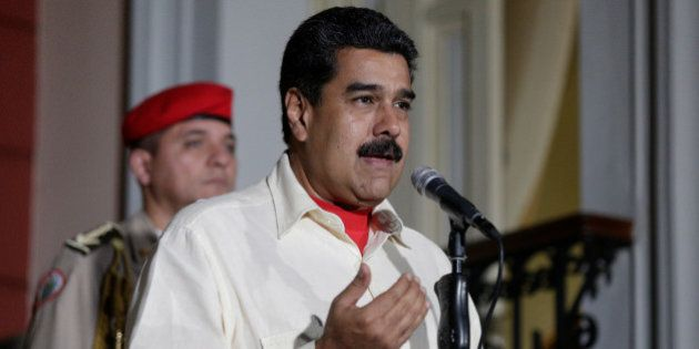 Venezuela's President Nicolas Maduro (C) talks to the media after his meeting with former Spanish prime...