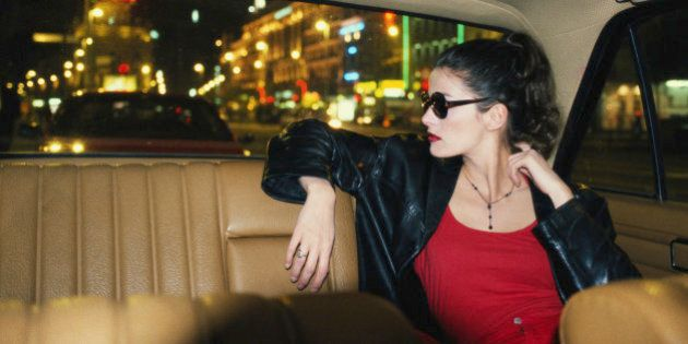 WOMAN IN TAXI AT