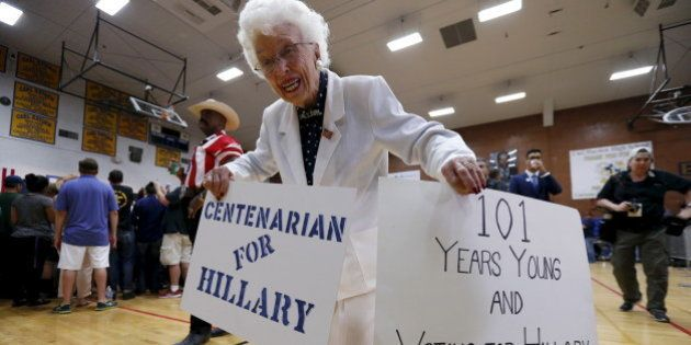 Supporter Jerry Emmett holds signs before a campaign rally by Democratic U.S. presidential candidate...