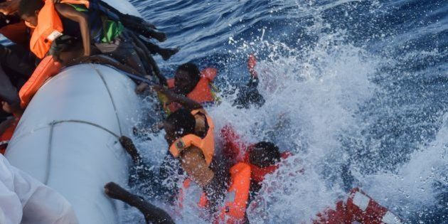 Migrants and refugees panic as they fall in the water during a rescue operation of the Topaz Responder...