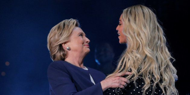 U.S. Democratic presidential nominee Hillary Clinton is joined by artist Beyonce at a campaign concert...