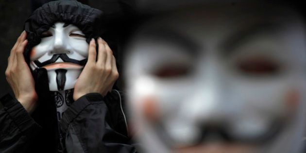 Protesters wearing Guy Fawkes masks made popular by the graphic