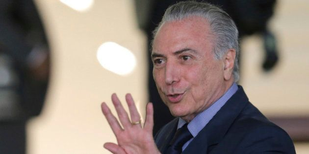 Brazil's President Michel Temer speaks to journalists after a meeting with Supreme Court President Carmem...