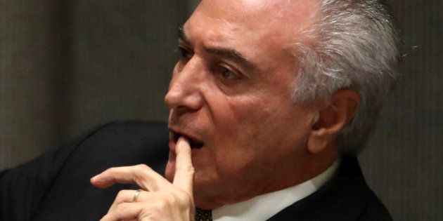 President Michel Temer of Brazil listens during a high-level meeting on addressing large movements of...