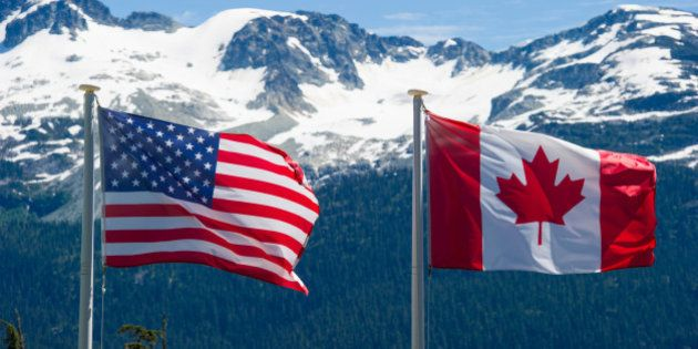 Canadian and American flags in the