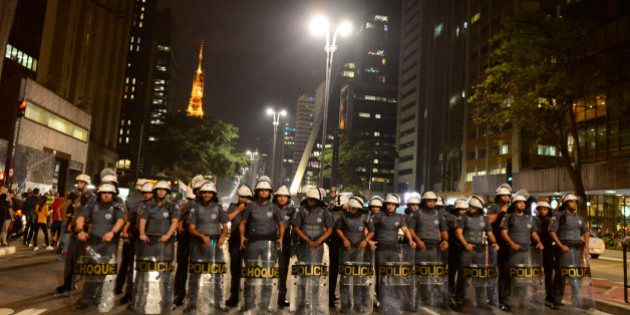 Police face off against Rousseff supporters at a rally at Avenida Paulista when President Dilma Rousseff...