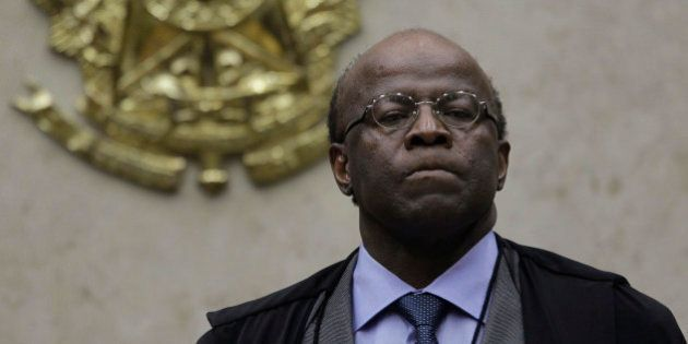 Chief Justice Joaquim Barbosa presides over a court session to hear the appeals of 25 people convicted...