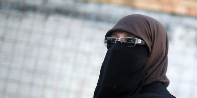 Indira Sinanovic, first Bosnian woman wearing a niqab to run in local elections in Bosnia, attends a...