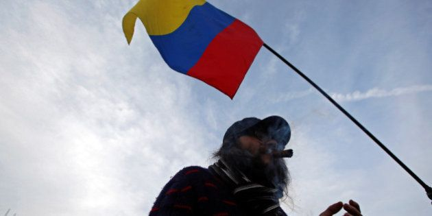 A supporter of the peace deal signed between the government and Revolutionary Armed Forces of Colombia...