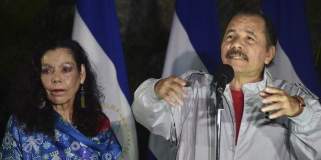Nicaraguan President Daniel Ortega (R) delivers a speech next to his wife Rosario Murillo after voting...