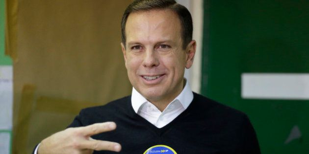 Joao Doria, mayoral candidate with the Brazilian Social Democracy Party gestures after voting in the...