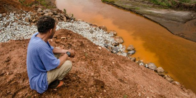 Ex-resident of Bento Rodrigues watches the construction of the S4 dam. Samarco is building in the Bento...