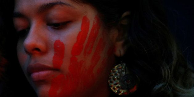 A demonstrator is pictured during a protest against rape and violence against women in Rio de Janeiro,...