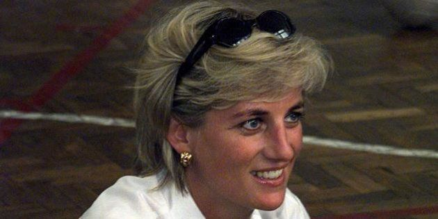 FILE PHOTO 9AUG97 - Diana, Princess of Wales sits cross-legged on the floor as she chats with members...