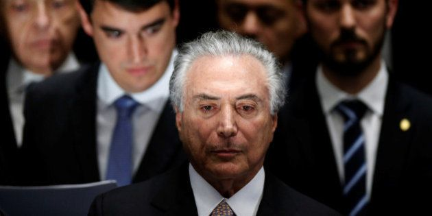 Brazil's new President Michel Temer attends the presidential inauguration ceremony after Brazil's Senate...