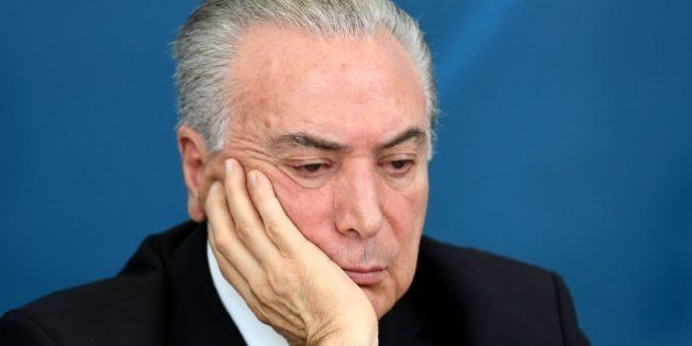 Brazil's President Michel Temer gestures during a meeting of the Economic and Social Development Council...