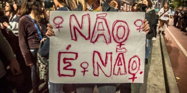 SAO PAULO, BRAZIL - JUNE 08: A woman holds a banner during a protest against the gang rape of a 16-year-old...