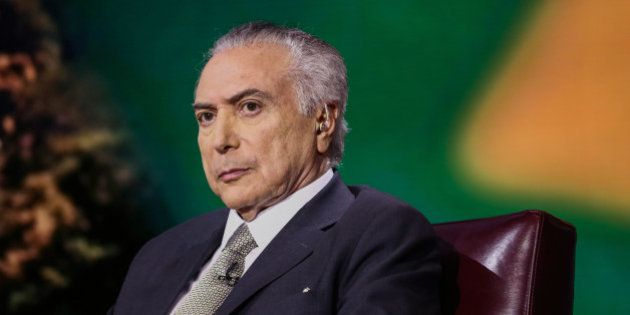 Michel Temer, president of Brazil, listens during a Bloomberg Television interview in New York, U.S.,...