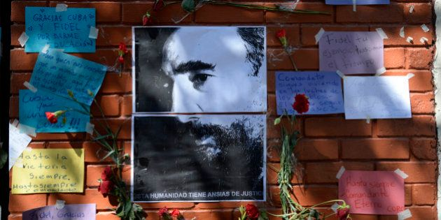 Flowers, pictures and messages placed outside the Cuban embassy in Guatemala City on November 28, 2016,...