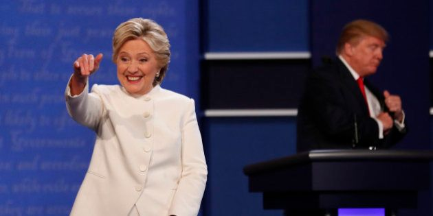 Democratic U.S. presidential nominee Hillary Clinton reacts near Republican U.S. presidential nominee...