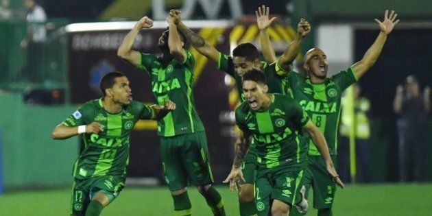 Players of Brazil's Chapecoense celebrate after defeating Argentina's Independiente in a penalty shoot-out...