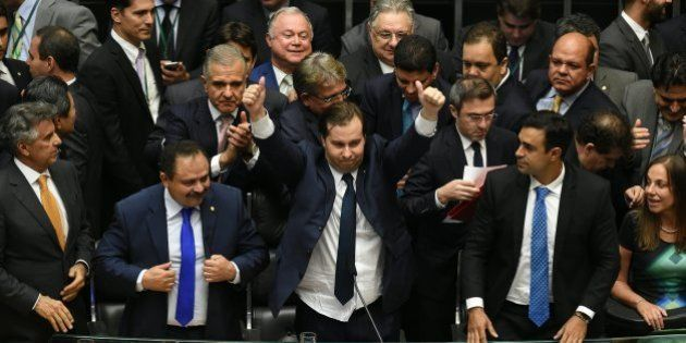The new president of the Brazilian Lower House, Rodrigo Maia (C), of the Democrats Party (DEM), gives...