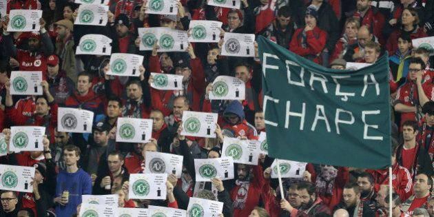 TORONTO, ON- NOVEMBER 30 - Fans hold up a banner and signs in honour of Brazilian club Chapecoense that...