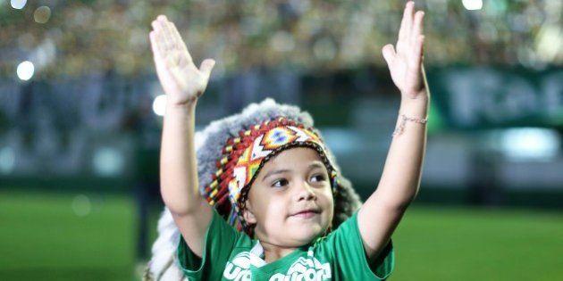 CHAPECO, BRAZIL - NOVEMBER 29: A young fan pays tribute to the players of Brazilian team Chapecoense...
