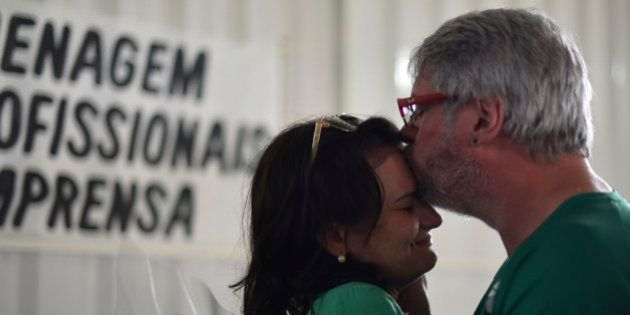 People pay tribute to journalists killed in a November 28 plane crash in the Colombian mountains, at...