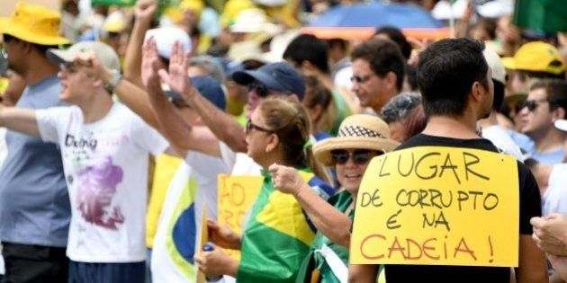 Demonstrators protest in front of the National Congress in Brasilia against corruption and in support...