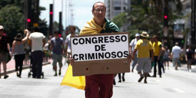 Demonstrators protest along Paulista Avenue in Sao Paulo, Brazil on december 4, 2016 against corruption...