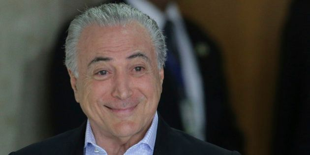 Brazil's President Michel Temer arrives for a press conference about proposed anti-corruption legislation...