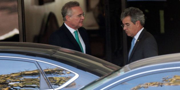 Senator Renan Calheiros, president of the Brazilian Federal Senate, (L) talks with senator Jorge Viana...