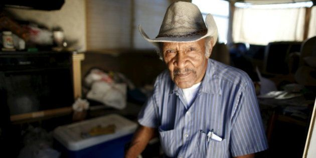 Samuel Cole, 85, poses for a portrait in the motorhome in which he lives on the streets of Los Angeles,...