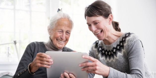 Two generation women looking at tablet