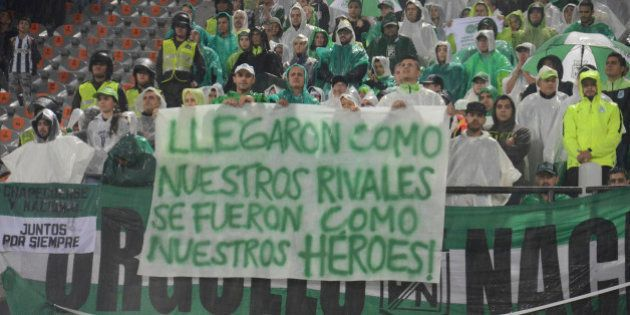 MEDELLIN, COLOMBIA - DECEMBER 03: Fans of Atletico Nacional display a banner that reads in spanish 'You...