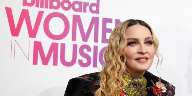 Madonna poses on the red carpet a the Billboard Magazine's 11th annual Women in Music luncheon in New...
