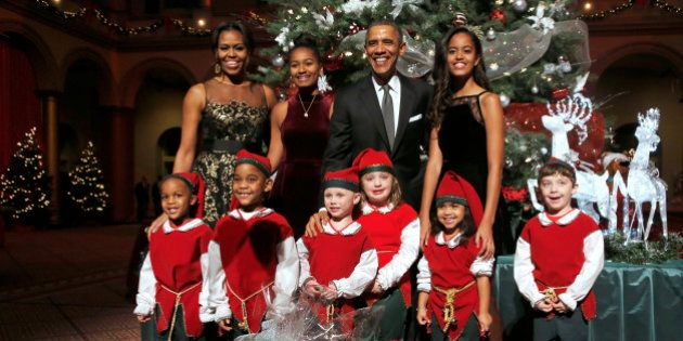 U.S. President Barack Obama (top 2nd R), first lady Michelle Obama (top L) and their daughters Malia...