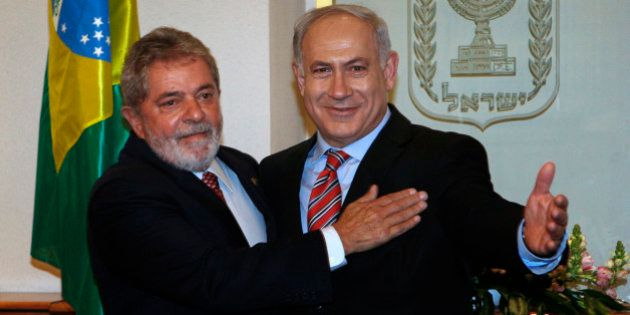 Brazilian President Luiz Inacio Lula da Silva, left, embraces Israeli Prime Minister Benjamin Netanyahu...
